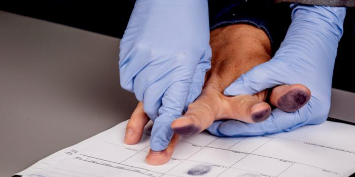 public mugshots - taking a suspect's fingerprints