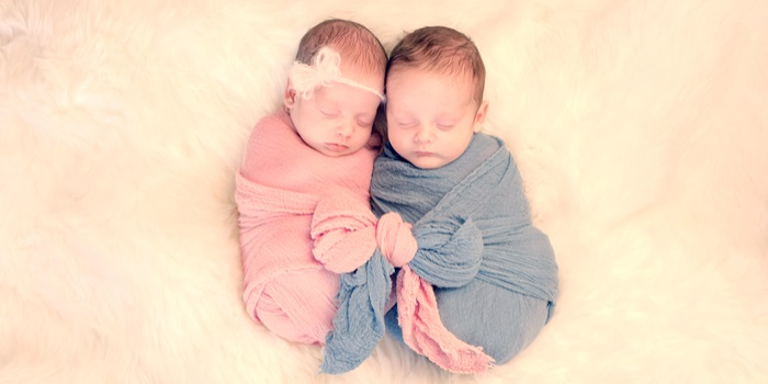 popular baby names baby boy and baby girl laying side by side