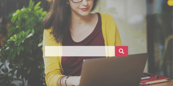 online word search - a woman sitting behind an illustration of a search field