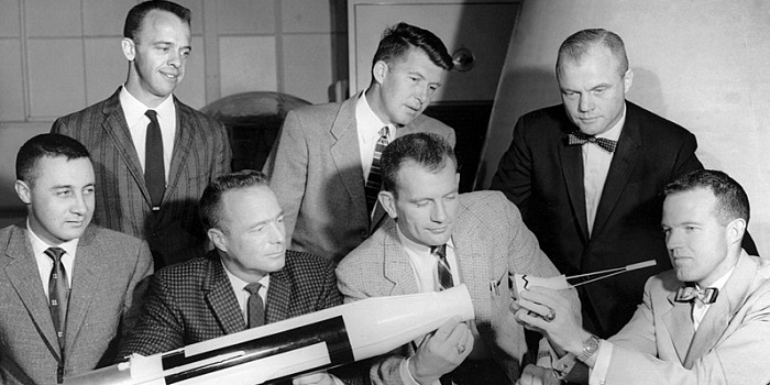 First Astronauts in the United States - the mercury seven looking at a model rocket