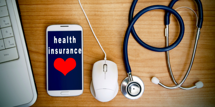 types of medical insurance - a phone with the words health insurance written on it