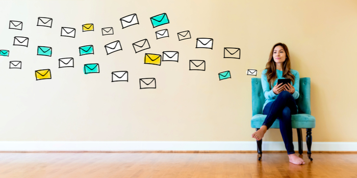 how email works - a woman sitting on a chair with letters flying near her