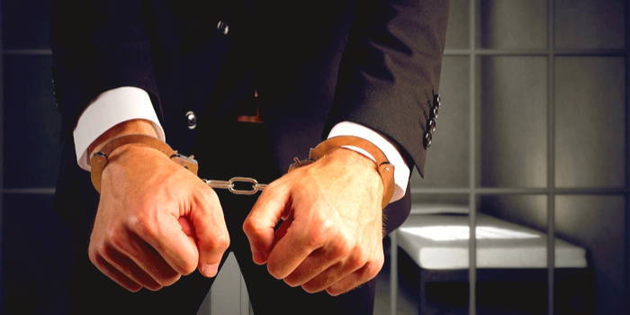 free arrest records - a handcuffed business man