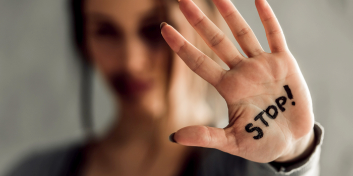 sexual abuse in Hollywood - the word stop written on a palm of a hand