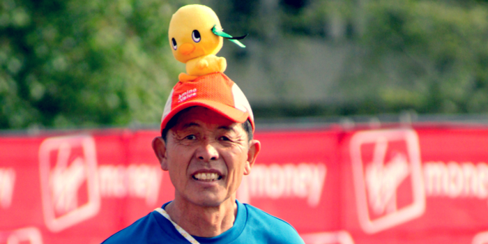 weird state laws - a man with a stuffed duck on his head