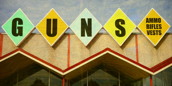 a store sign that says guns