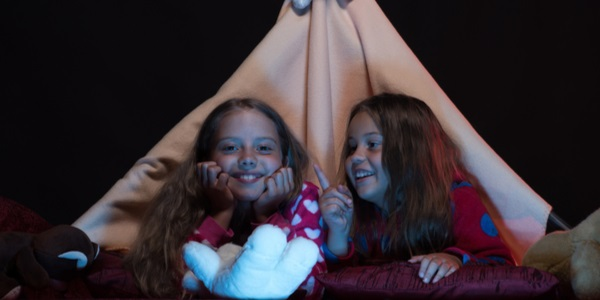 two girls under an indoor tent