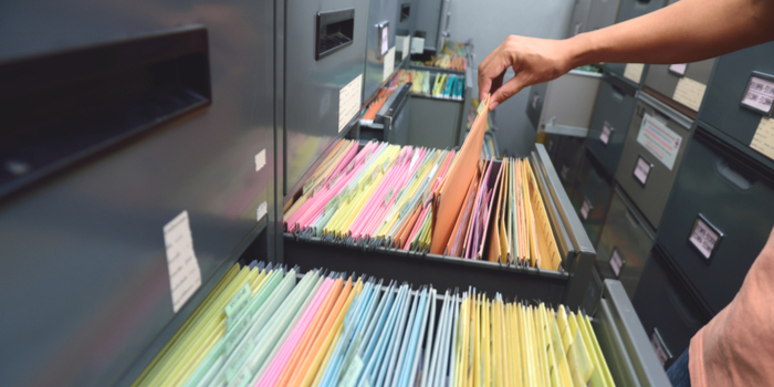 view public records - a man's hand going through records