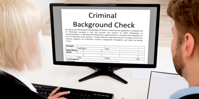 background check - two people conducting an online background check