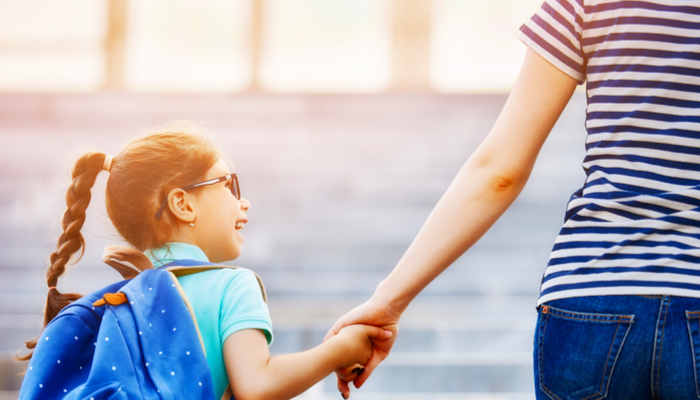how to choose a school - a mom walking her child