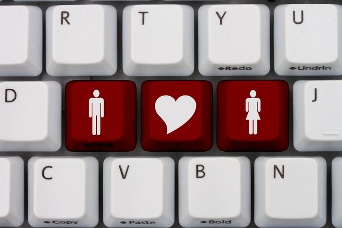 keyboard keys of a heart symbol between a man and a woman symbol