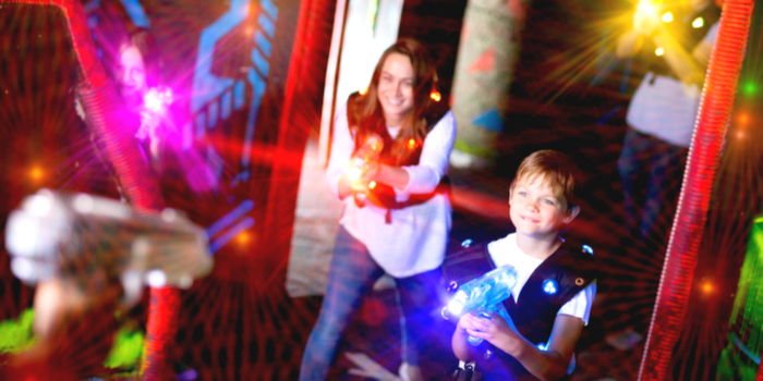 Dallas TX - a family playing laser tag