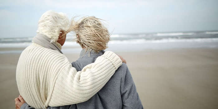 what is monogamy - a senior couple looking at the ocean