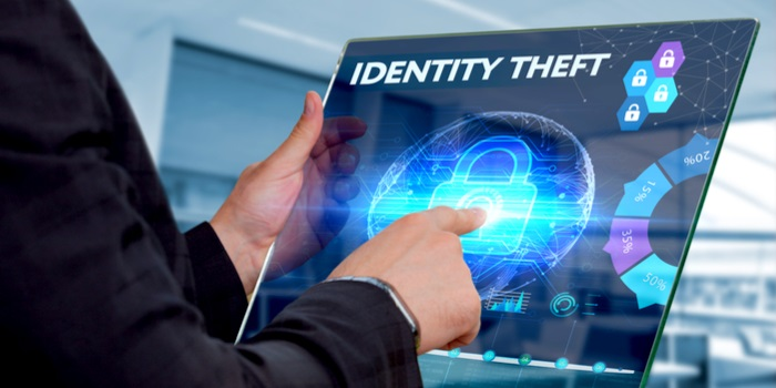 identity theft stats a hand clicking in a touch screen