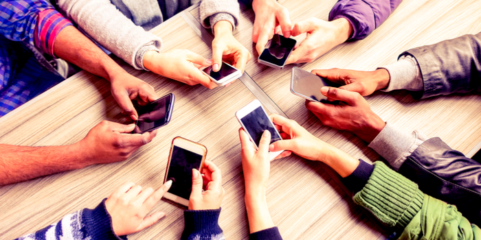 phone number directory - a group of people holding cell phones