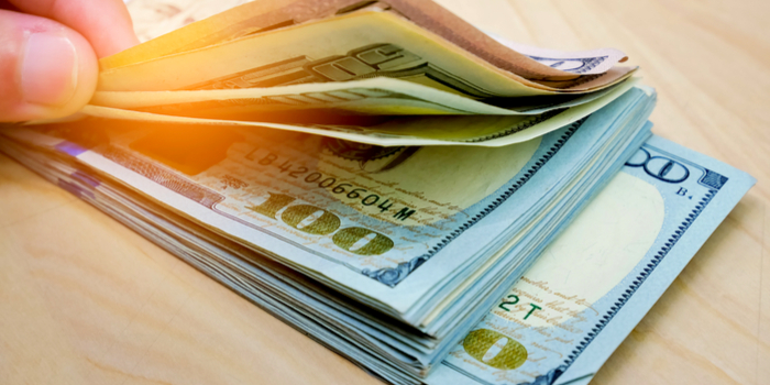 unclaimed cash - a hand fanning out money bills