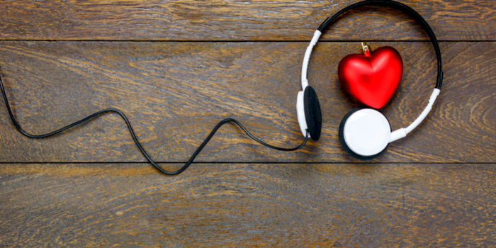 Most popular love songs - headphones surrounding a heart ornament