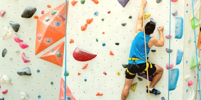gifts for boyfriends - a man climbing a rock wall