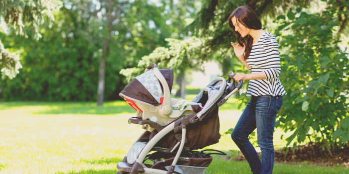 tips for new moms - a mother taking her baby for a walk