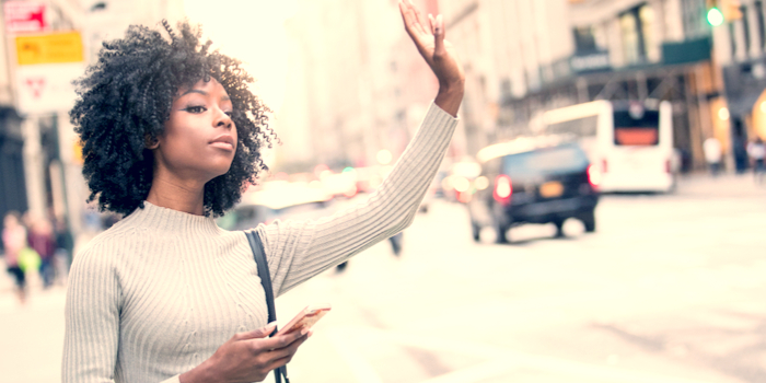 uber background checks - a woman raising her hand for a ride
